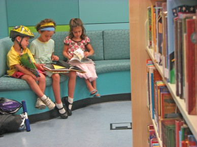 Opinions_Dembkoski_Children reading on the couch_San José Public Library_flickr